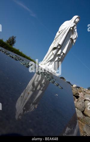 Maria Statue on graveyard monument in Workum, Fryslan, The Netherlands - Stock Photo