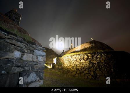 traditional Scottish Blackhouse at night on the Isle of Harris Western Isles Outer Hebrides Scotland - Stock Photo