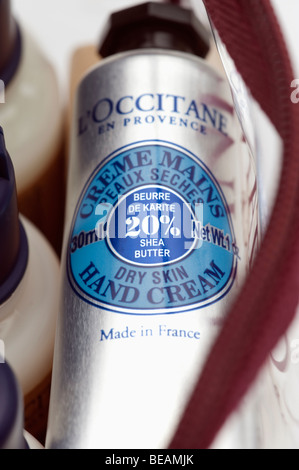 Tube of L'Occitane  dry skin hand cream in a cosmetic pack - Stock Photo