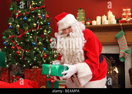 Santa Claus Putting Gifts Under