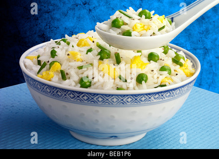 EGG FRIED RICE WITH PEAS - Stock Photo