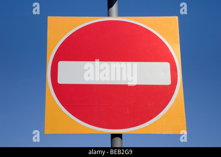 No entry road sign isolated on a blue sky. England, UK, Britain - Stock Photo