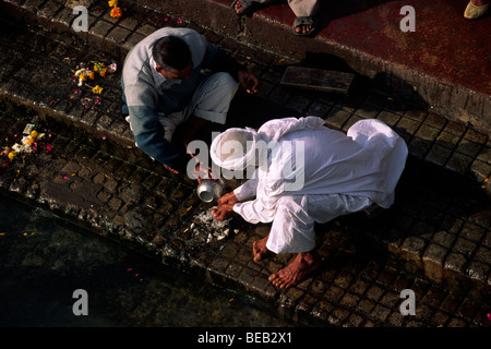 india, uttarakhand, haridwar, people giving offerings to the river ganges - Stock Photo