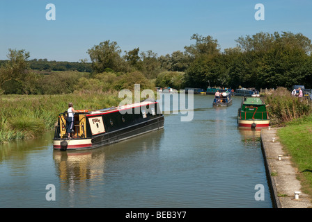 One woman steering narrow boat on Kennet and Avon Canal - Stock Photo
