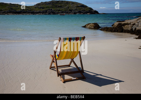 Unoccupied Deck Chair on the remote seaside beach, summer, vacation, travel, sea, holiday at  Sandwood Bay, Sutherland, - Stock Photo