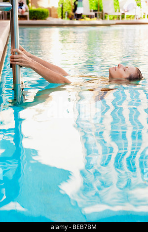 Woman in a swimming pool, Biltmore Hotel, Coral Gables, Florida, USA - Stock Photo