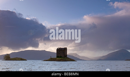 Castle Stalker in Appin country sits on it's rocky island platform  at the end of Loch Linnhe, Highland Scotland. - Stock Photo
