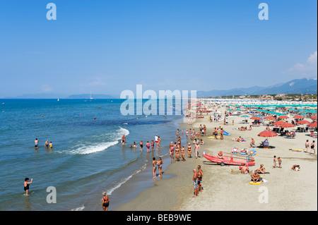 Beach at Marina di Pietrasanta with the town and mountains behind ...