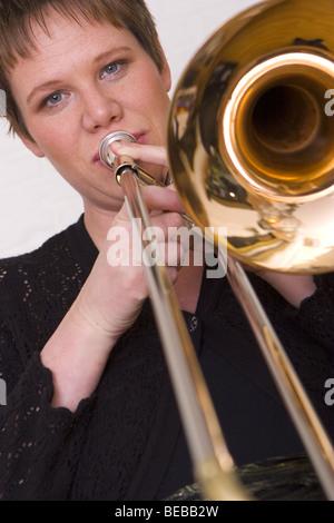 Woman playing trumpet - SerieCVS417203c - Stock Photo
