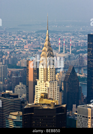A view of the 'Chrysler Building' from the 'Empire State Building' in 'New York City,' 'New York.' - Stock Photo