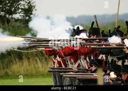 Musket firing demonstration at a historical re-enactment event - Stock Photo