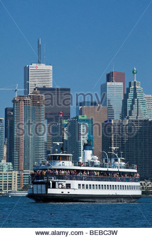 Ferry on way to Toronto Islands Park with city in background at Toronto Ontario Canada - Stock Photo
