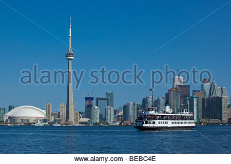 Ferry on way to Toronto Islands Park with skyline in background at Toronto Ontario Canada - Stock Photo