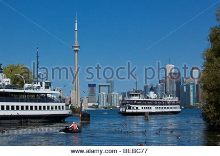 Ferry arriving at Toronto Islands Park with skyline in background at Toronto Ontario Canada - Stock Photo