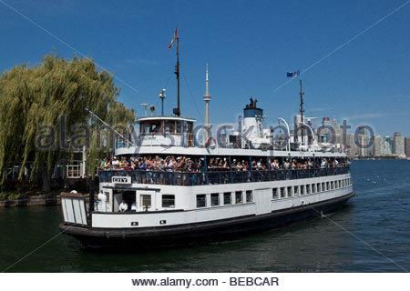 Ferry arriving at Toronto Islands Park at Toronto Ontario Canada - Stock Photo