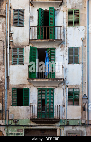 Balconies and shuttered windows in dirty back street Palma Mallorca Spain - Stock Photo