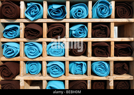 Wooden shelf with rolled blankets for guests feeling cold, terrace of a beach restaurant, Bergen aan Zee, Holland, - Stock Photo