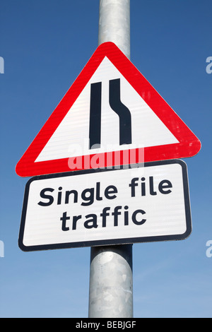 British single file traffic road sign. - Stock Photo