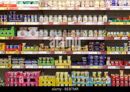 yogurt shelf in a supermarket - Stock Photo