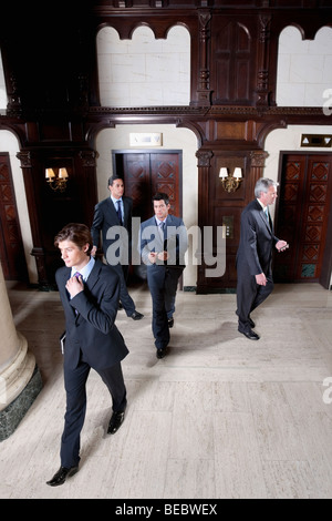 Four businessmen walking in a hotel lobby, Biltmore Hotel, Coral Gables, Florida, USA - Stock Photo