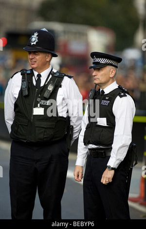 British policemen on duty outside the Houses of Parliament in London - Stock Photo