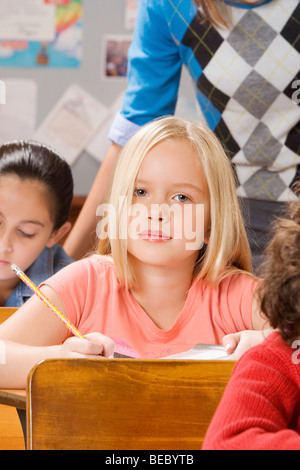 Students with their teacher in a classroom - Stock Photo
