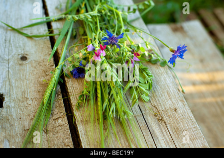 bunch of wild flowers and cereals on a wood board. small GRIP - Stock Photo