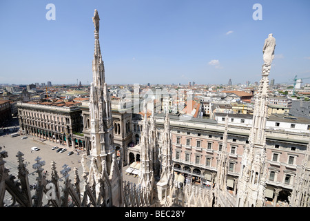 Milan skyline, from the roof of the cathedral, looking out north west over the square (Piazza del Duomo), Lombardy, - Stock Photo