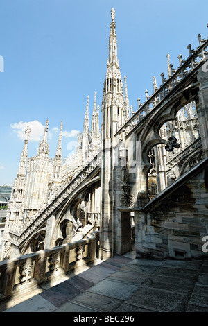 Flying buttress supporting the roof of Milan cathedral, with statues on top of spires, Lombardy, Italy - Stock Photo