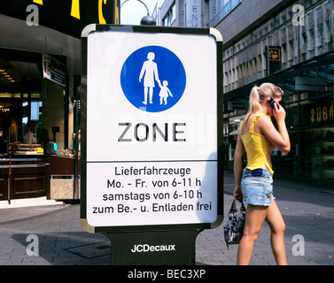 Sign denoting the boundary of the pedestrianised shopping area in Koln town centre, Germany (and pedestrian). - Stock Photo