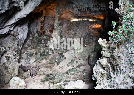 A giant cave on an island in Halong Bay, Vietnam - Stock Photo