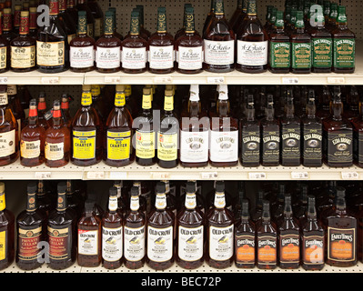 Selection of bourbon whiskey on shelf of liquor store Houston Texas USA - Stock Photo