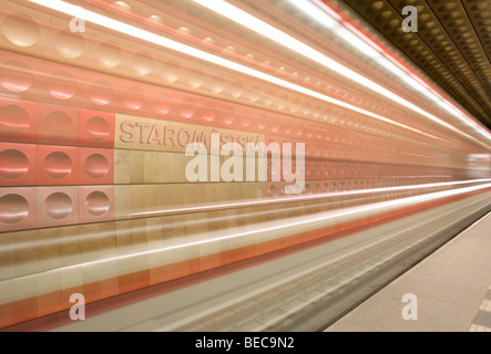 Metro flying past the Staromestska metro station in Prague, Czech Republic. - Stock Photo
