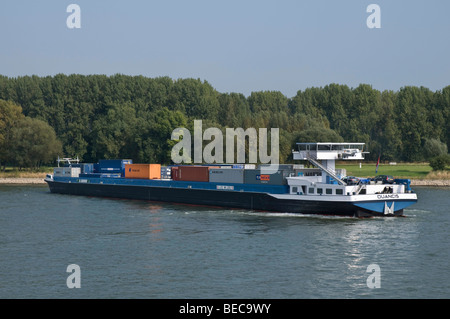Barge, container ship Duancis on the Rhine River near Bonn during a turning maneuver, North Rhine-Westphalia, Germany, - Stock Photo