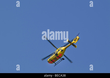 Air rescue helicopter from the ADAC Luftrettung GmbH, ambulance helicopter, Christoph 20 in flight seen from below - Stock Photo