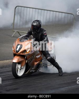 Dragster Bike at the national finals at Santa Pod, England. - Stock Photo