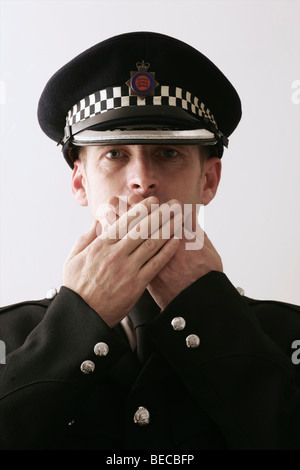 British Policeman on plain background - Stock Photo