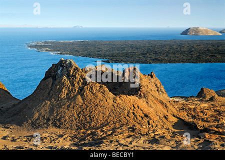 Primeval volcanic scenery with small crater, Bartolomé Island, view to Santiago, Galapagos Achipelago, UNESCO World - Stock Photo