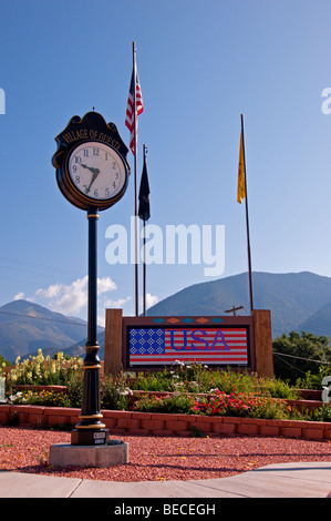 A towering timepiece stands tall in a memorial park in Questa, New Mexico. - Stock Photo