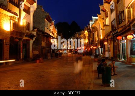 Street scenery with shops at dusk, Zhenyuan, Guizhou, China - Stock Photo