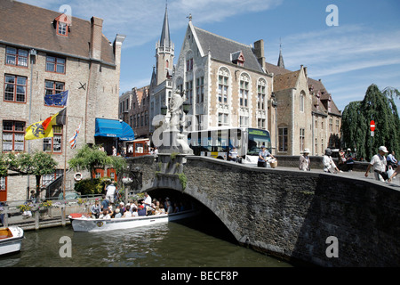 Mooring for boat tours through canals, historic center of Bruges, Flanders, Belgium, Europe - Stock Photo