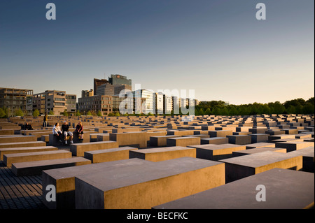 Evening mood at the Memorial to the Murdered Jews of Europe, the Holocaust memorial, in front of high-rise buildings - Stock Photo