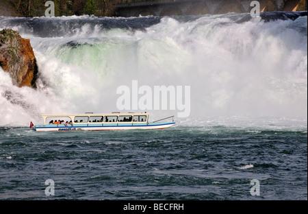 Excursion boat on the Rhine Falls near Schaffhausen, Switzerland - Stock Photo