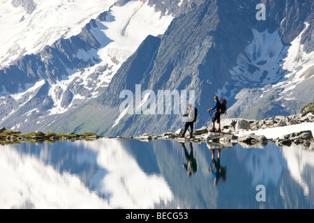 Hikers on the shore of the Friesenbergsee lake, Zillertal Alps, Northern Tyrol, Austria, Europe - Stock Photo