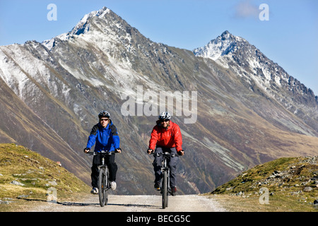 Mountainbikers in the high mountains, Kuehtai area, Northern Tyrol, Austria, Europe - Stock Photo