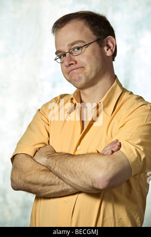 Man with crossed arms, body language - Stock Photo