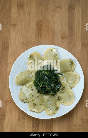 Pasta squares filled with ricotta and spinach with gorgonzola cheese - Stock Photo