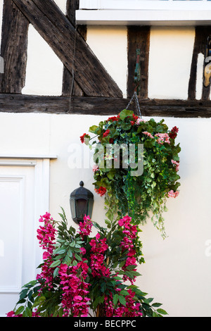 Flower Display on a Half Timbered Building Lavenham Suffolk England - Stock Photo