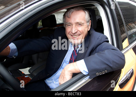 Erich Sixt, chief executive and main shareholder of the Sixt AG, sitting in a car with the Sixt logo - Stock Photo
