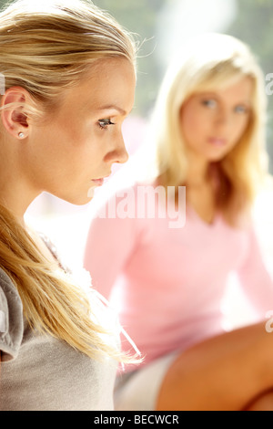 2 woman thoughtful - Stock Photo